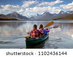 adventurous traveling couple... | Shutterstock . vector #1102436144