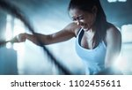 athletic female in a gym... | Shutterstock . vector #1102455611