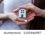 female hands holding small... | Shutterstock . vector #1102466987