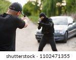 shootout between a police...   Shutterstock . vector #1102471355