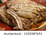 grilled t bone steak cooked on... | Shutterstock . vector #1102487651