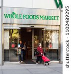 Small photo of New York, New York, USA - May 30, 2018: Whole Foods Market 6th Ave. in Manhattan. Whole Foods is known for quality non-processed foods. People can be seen.