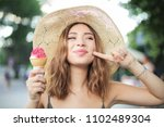 eating a tasty ice cream  | Shutterstock . vector #1102489304