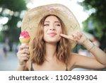 eating a tasty ice cream  | Shutterstock . vector #1102489304