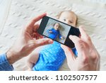 father taking a photo of his... | Shutterstock . vector #1102507577