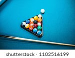 pool table with cue and rack of ... | Shutterstock . vector #1102516199