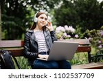 student sitting on bench... | Shutterstock . vector #1102537709