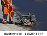 man smoothing asphalt with... | Shutterstock . vector #1102546949