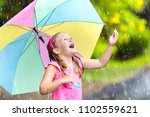 kid playing out in the rain....   Shutterstock . vector #1102559621