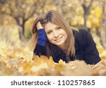 Smiling happy girl in autumn park. - stock photo