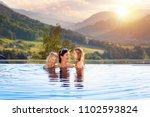 mother and kids play in outdoor ... | Shutterstock . vector #1102593824