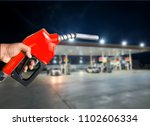 fuel nozzle has a red hand grip.... | Shutterstock . vector #1102606334