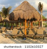 beach loungers and umrellas on... | Shutterstock . vector #1102610327