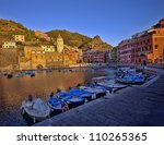 sunset in Vernazza fishing village, Cinque Terre, Italy - stock photo