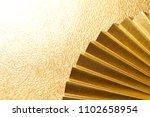 japanese golden folding fan    ... | Shutterstock . vector #1102658954