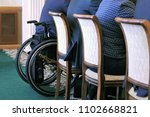 Small photo of Wheelchair at the official meeting. Discussion with participation of the invalid