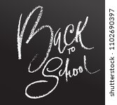 back to school. chalk lettering ... | Shutterstock .eps vector #1102690397