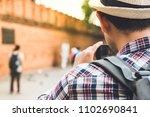 asian male tourist backpacker... | Shutterstock . vector #1102690841