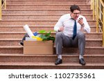 young businessman on the street ... | Shutterstock . vector #1102735361