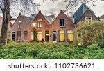 beautiful buildings of alkmaar... | Shutterstock . vector #1102736621
