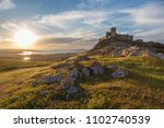 landscape and a sunset sky over ...   Shutterstock . vector #1102740539