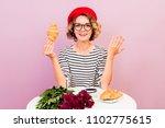 beautiful french girl looks... | Shutterstock . vector #1102775615