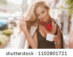 enthusiastic tanned woman plays ... | Shutterstock . vector #1102801721