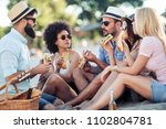 group of young people eating... | Shutterstock . vector #1102804781
