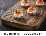 mini sandwiches with cream... | Shutterstock . vector #1102808357