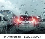 traffic in rainy day on the... | Shutterstock . vector #1102826924