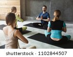 yoga teacher and beginners in...   Shutterstock . vector #1102844507