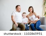 photo of happy young parents... | Shutterstock . vector #1102865951