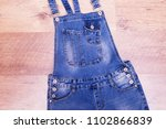 jeans overall on laminate. top... | Shutterstock . vector #1102866839