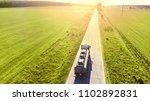gasoline truck is driving along ... | Shutterstock . vector #1102892831