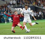 Small photo of KYIV, UKRAINE - MAY 26: Cristiano Ronaldo of Real Madrid (R) in action against Andy Robertson of Liverpool (L) during the UEFA Champions League final match in Kiev, 26 May 2018.