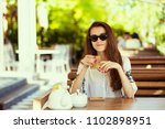happy woman at outdoors cafe | Shutterstock . vector #1102898951