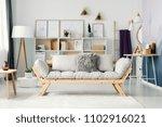 beige sofa in bright  scandi... | Shutterstock . vector #1102916021