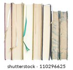 row of vintage books w. bookmarks, close up, isolated - stock photo
