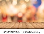 wood table top on white blurred ... | Shutterstock . vector #1103028119