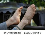 crossed feet relax foot... | Shutterstock . vector #1103045459