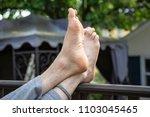 crossed feet relax foot... | Shutterstock . vector #1103045465