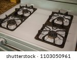 gas stove clean four burners... | Shutterstock . vector #1103050961