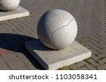 stone balls on a city street.... | Shutterstock . vector #1103058341