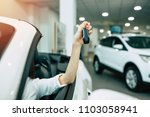 woman hand with car key.... | Shutterstock . vector #1103058941