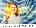 smiling woman touching digital... | Shutterstock . vector #1103061197