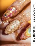 Small photo of Handmade manicure is covered with brilliant paint