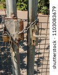 Small photo of Closed gate with big steel chain and padlock