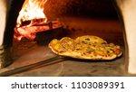 italian pizza in  wood oven | Shutterstock . vector #1103089391