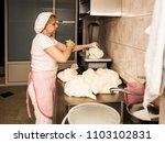 woman baker working in bakery... | Shutterstock . vector #1103102831
