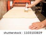 man baker working in bakery shop | Shutterstock . vector #1103103839
